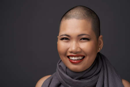 vietnamese ethnicity: Face of laughing Vietnamese woman with shaved hairstyle