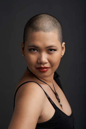 vietnamese ethnicity: Portrait of beautiful Vietnamese woman with shaved hair looking at the camera