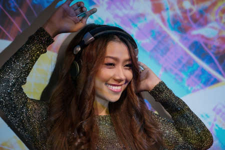 sund: Attractive Asian female dj performing in the nightclub