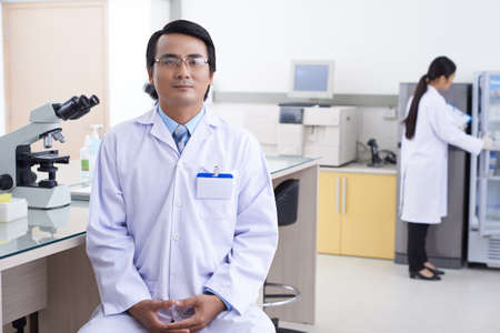 pharmacologist: Portrait of Vietnamese pharmacologist in the modern laboratory