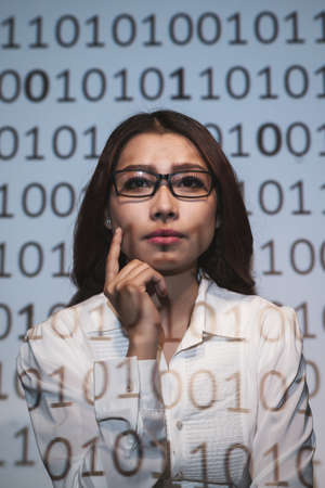 cryptogram: Pensive female scientist looking at the binary code