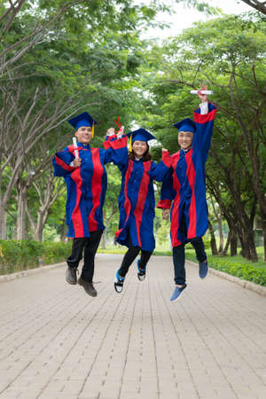 schoolmate: High school graduates jumping with happiness after getting diploma