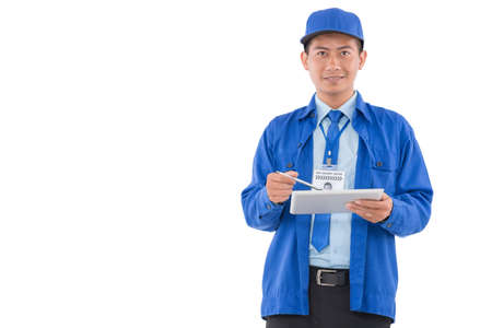 confirmed: Portrait of Vietnamese delivery man in uniform holding a tablet computer