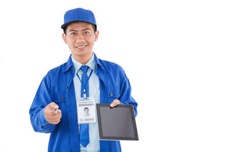 Smiling Vietnamese courier giving you a digital tablet and a stilus to confirm delivery Stock Photo