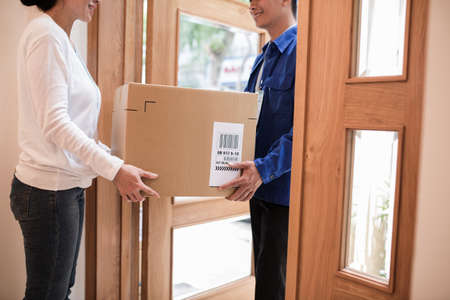 Cropped image of parcel delivery process Stock Photo