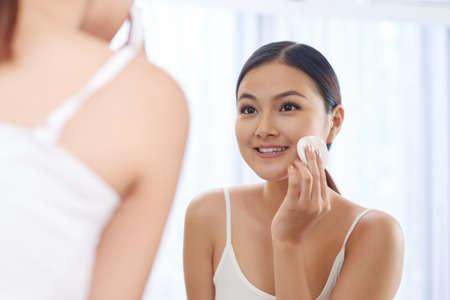 Applying face toner