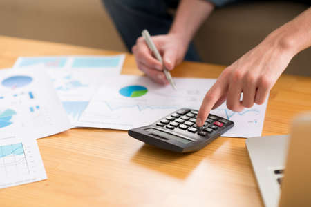 Close-up image of accountant working with financial documents Stock Photo