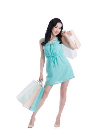 Studio shoot of lovely Mongolian woman holding paper bags