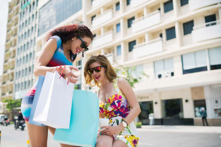 Women showing her purchases to her friend