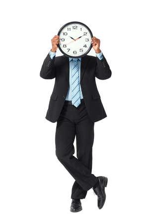 puntualidad: Retrato conceptual de empresario mostrando importancia del tiempo