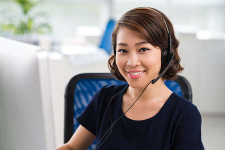 Portrait of pretty smiling woman in headset Stock Photo