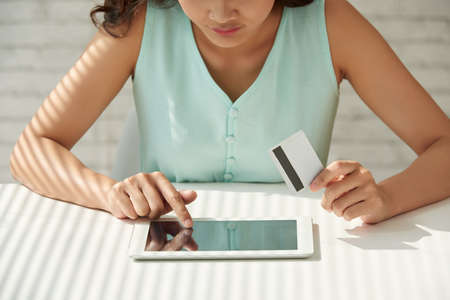 card making: Cropped image of girl with credit card making order online Stock Photo