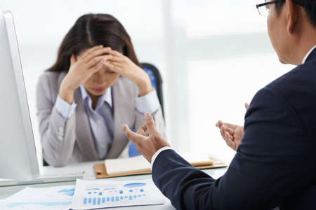 Businessman is unhappy with work of his assistant