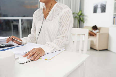 Cropped image of female executive working from home
