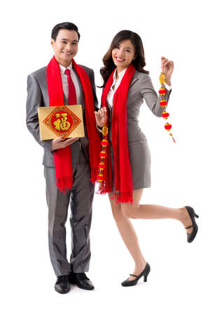 Full-length portrait of business couple with chocolate box and garland for New Year celebration
