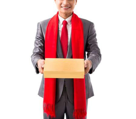 Cropped image of smiling man giving you a present