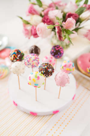 Different cake pops on the stand, selective focus