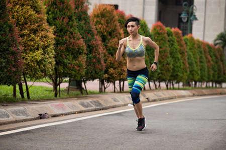Young Vietnamese woman training for marathon run Stock Photo - 76860378