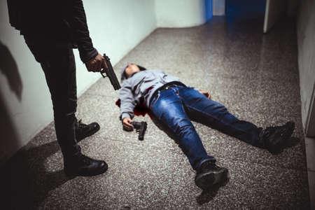 Hitman with dead victim