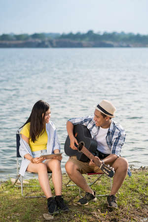 Young  Vietnamese couple enjoying their date at the lakeside Stock Photo