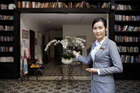 Smiling hospitable receptionist welcoming you at the hotel