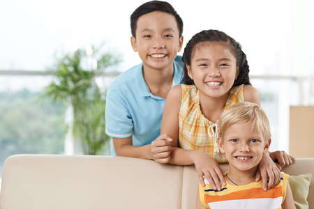 Portrait of happy Asian and Caucasian boys and girl Stock Photo