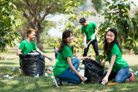 Team of activists collecting litter in the park