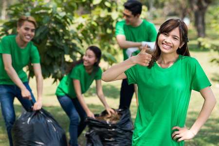 Cheerful young volunteer showing thumbs-up Stock Photo