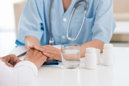 General practitioner prescribing different pills to the patient Stock Photo