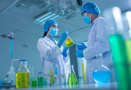Asian team of chemists conducting research in the laboratory