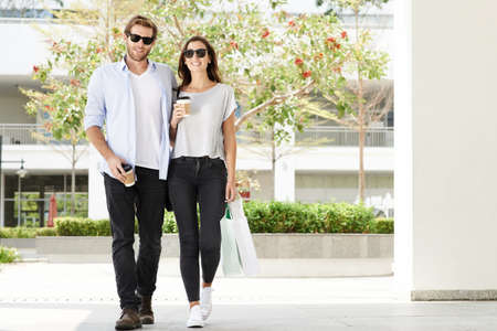 Couple walking outdoor after shopping