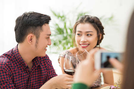 Man and woman chatting and drinking wine at party Stock Photo