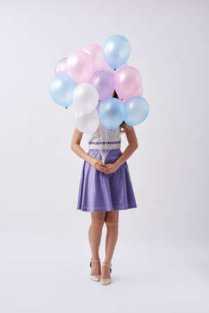 multiple: Birthday girl with bunch of colorful  balloons