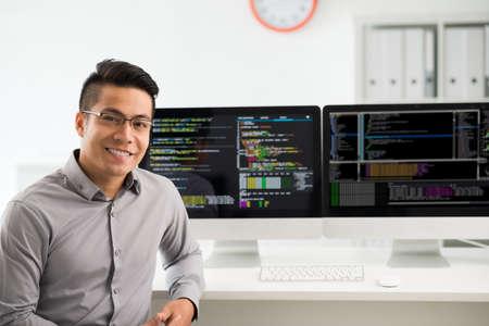 Portrait of smiling Vietnamese software engineer