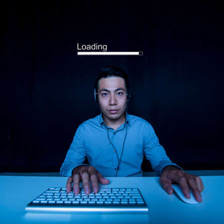 Developer waiting when programs and libraries are loading Stock Photo
