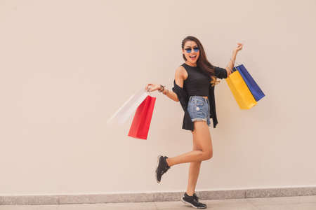 Portrait of excited young woman with paper-bags Stock Photo
