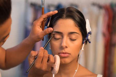 close uo: Close-uo image of male make-up artist applying eyeshadow Stock Photo