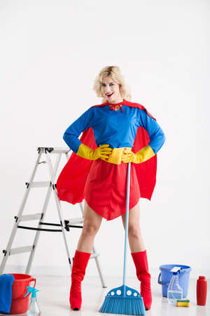 Energetic superwoman ready to clean the house Stock Photo