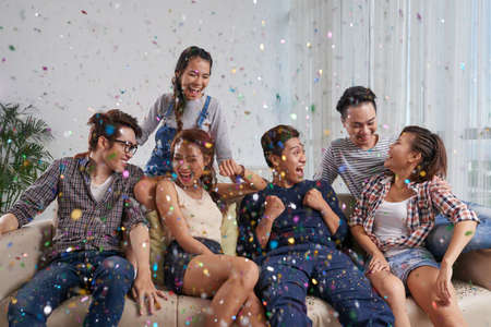 Joyful young people enjoying party at home