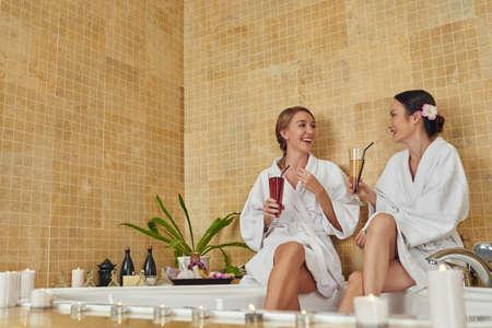 Women having fun in luxury spa salon