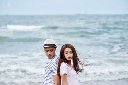 Vietnamese young couple having difficulties in relationship Stock Photo