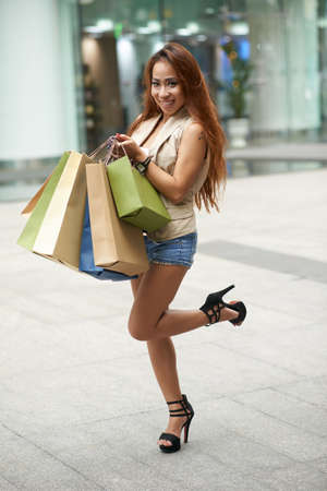 Attractive young Asian woman excited after shopping Stock Photo