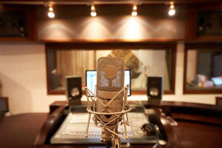 Microphone in empty music studio, selective focus Stock Photo