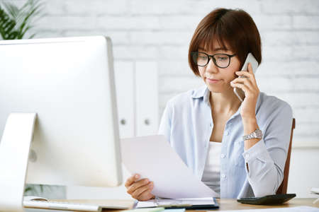 woman on phone: WOrking lady Stock Photo