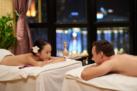 Young couple relaxing together in spa salon Stock Photo