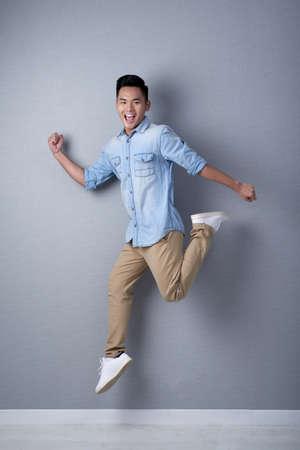 Studio Shot of Asian Man in Motion 스톡 콘텐츠