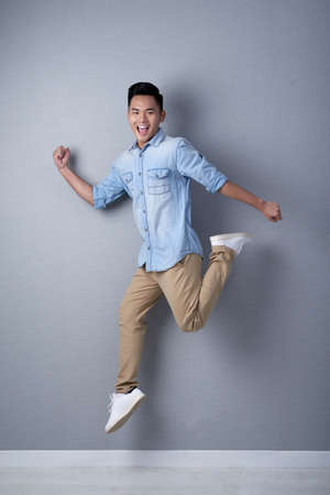 Studio Shot of Asian Man in Motion Banco de Imagens