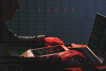 cybercrime: Unrecognizable internet criminal attacking database firewall on laptop with computer virus Stock Photo