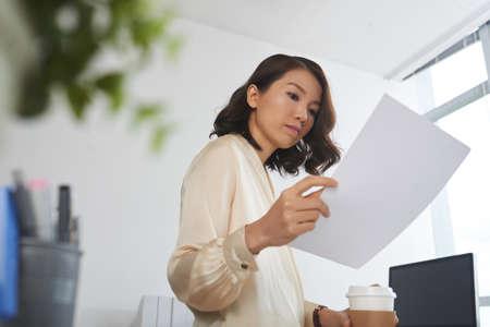 Female manager reading document