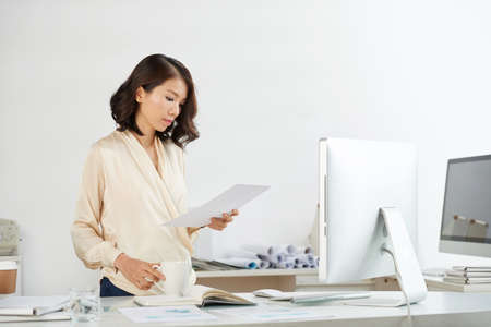 Vietnamese businesswoman checking document